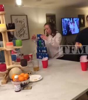knocking down her beer tower