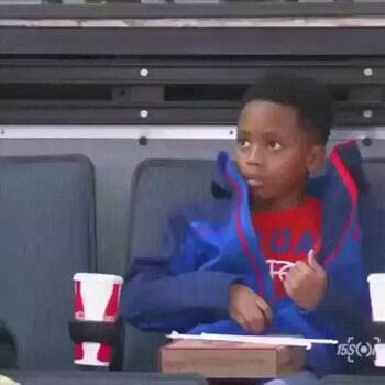 kid seeing himself on the jumbotron