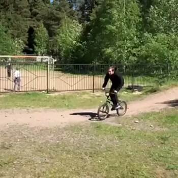 Showing off his bike trick