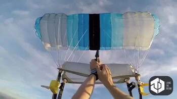 Skydiver sets their parachute on fire