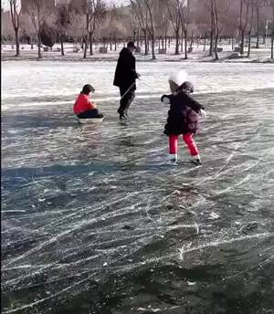 Little girl showing off her ice skating tricks