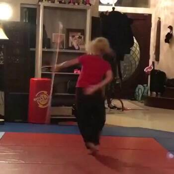Girl has some serious bow staff moves