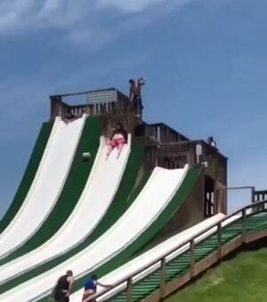 Just a fat guy having some fun on a water slide