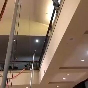 Amazing second story jump onto a trampoline